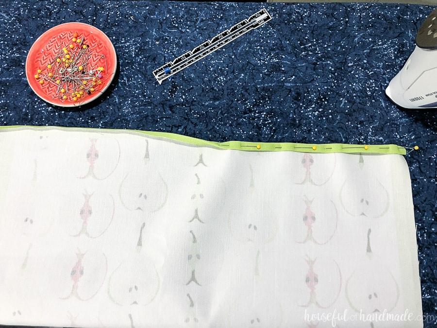 Use a hem gauge to easily create a rolled hem around your handmade tea towel.
