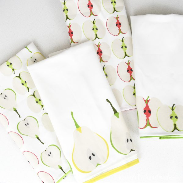 Four DIY tea towels made from custom printed fabric.