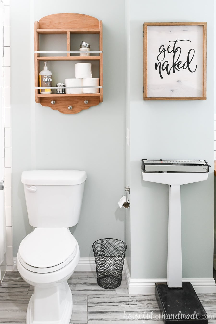 Bathroom with DIY wall jewelry organizer with a wood sign front.