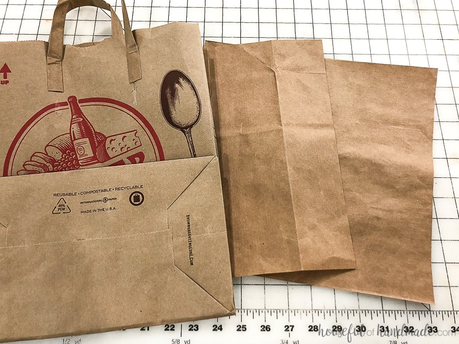 Brown paper grocery bag cut into paper sized pieces to make gingerbread house paper Christmas ornaments.
