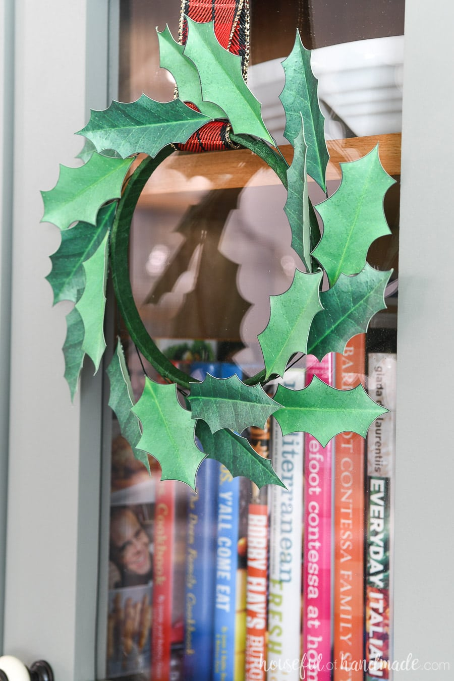 Close up of the paper Christmas wreath handing on the cabinet door. Best easy paper Christmas decor!