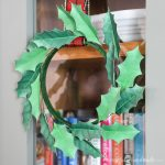 Close up of the detail on the paper holly wreath.
