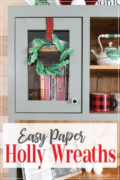 Paper Holly wreath on a hutch with words over the bottom of the photo.