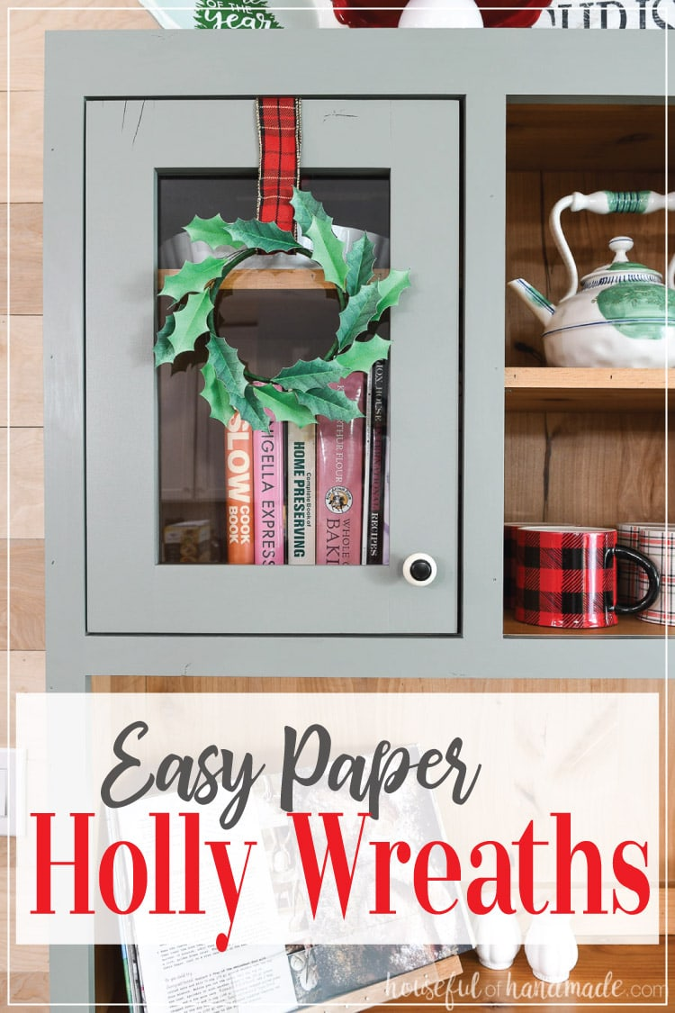 Save lots of money this Christmas by decorating with these beautiful paper Christmas wreaths. The simple paper holly wreaths are perfect for adding holiday decor to any surface. Decorate your kitchen cabinets, bookcases, mirrors, and more for Christmas. Housefulofhandmade.com | #christmas #papercrafts #paperdecor #wreath
