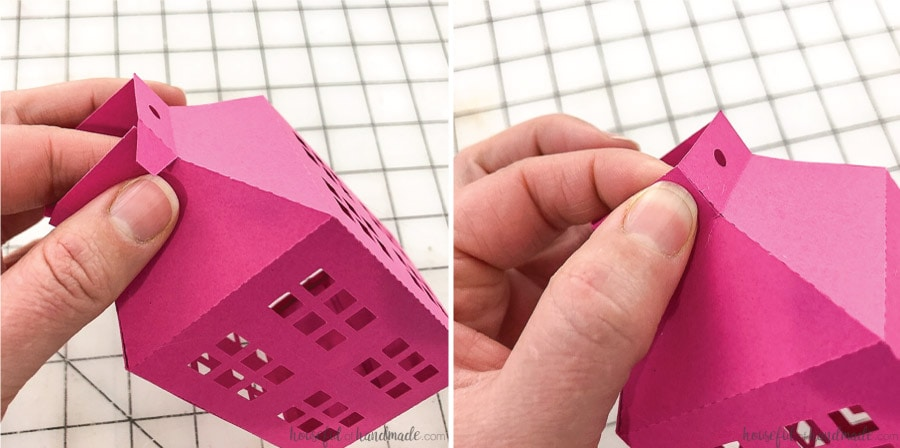 Closeup of how to secure the top flaps of the paper Christmas lanterns.
