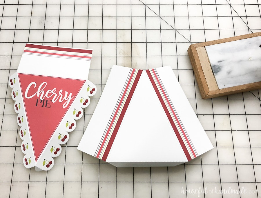 The two pieces of the printable leftover pie boxes template cut out and folded along the dotted lines.