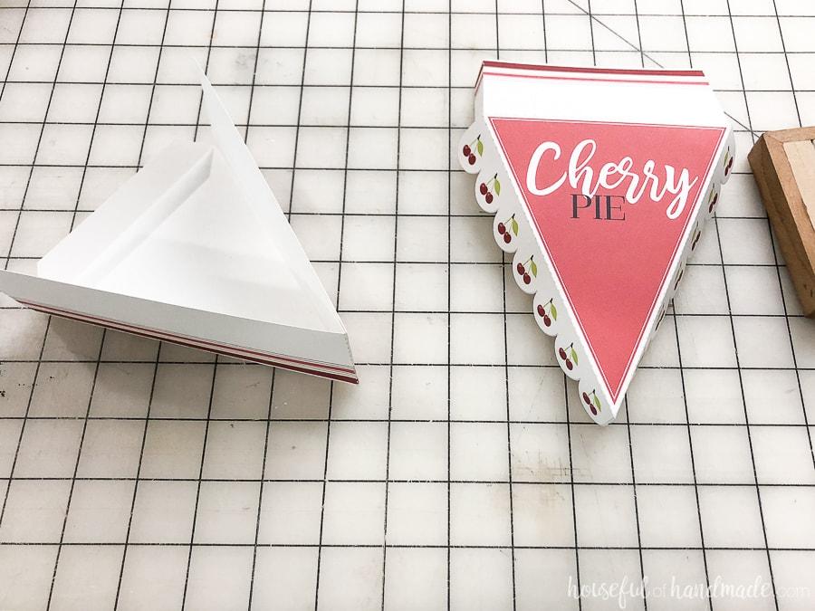 The tip of each pie box glue to make a V.
