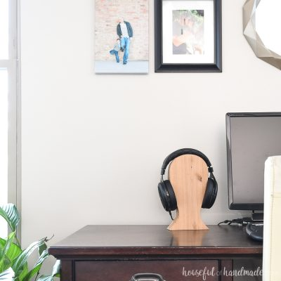 Desk with DIY headphone stand on the side of the computer.