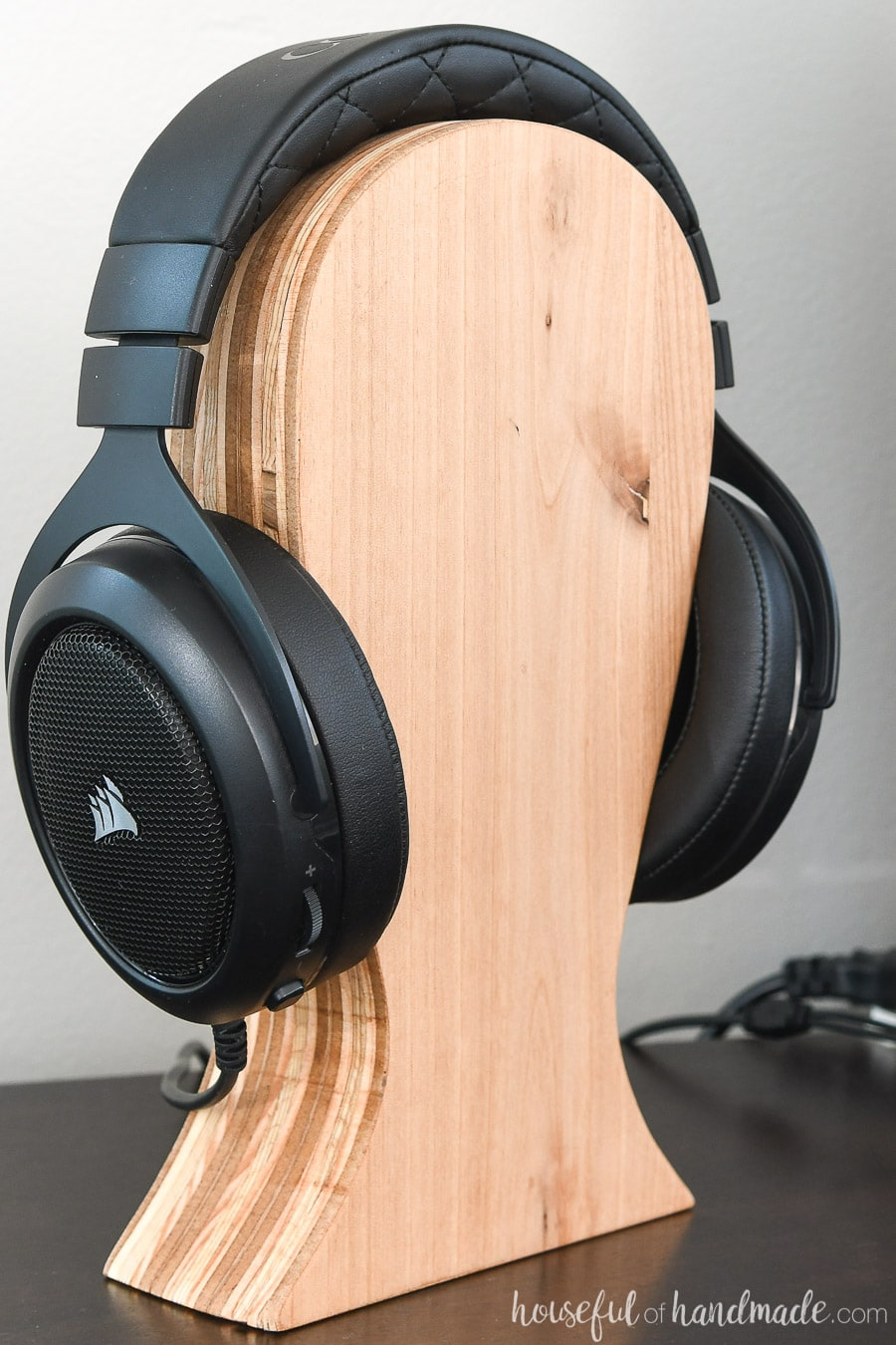 Close-up of the plywood striping on the side of the DIY headphone stand.