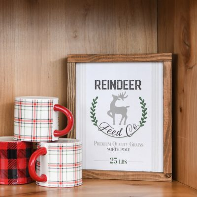 Easy DIY wood sign that says Reindeer Feed Co. on it.