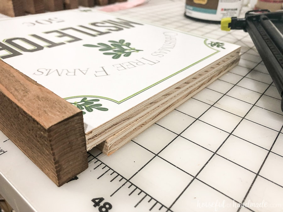 Attaching the side frames of the Easy DIY wood signs.