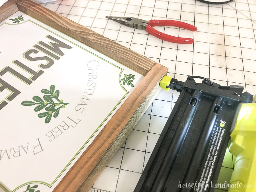 Attaching the rest of the frame pieces for the Easy DIY wood signs.