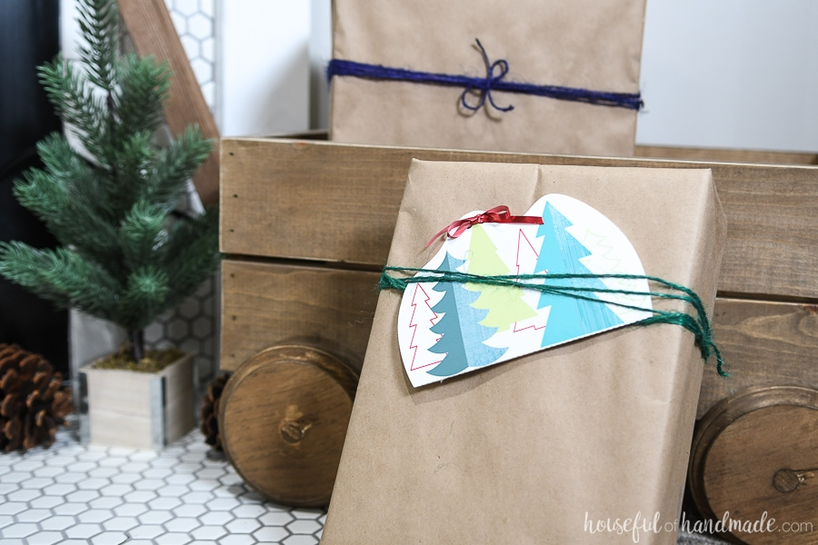Christmas tree patterned gift card holder attached to the front of a present.
