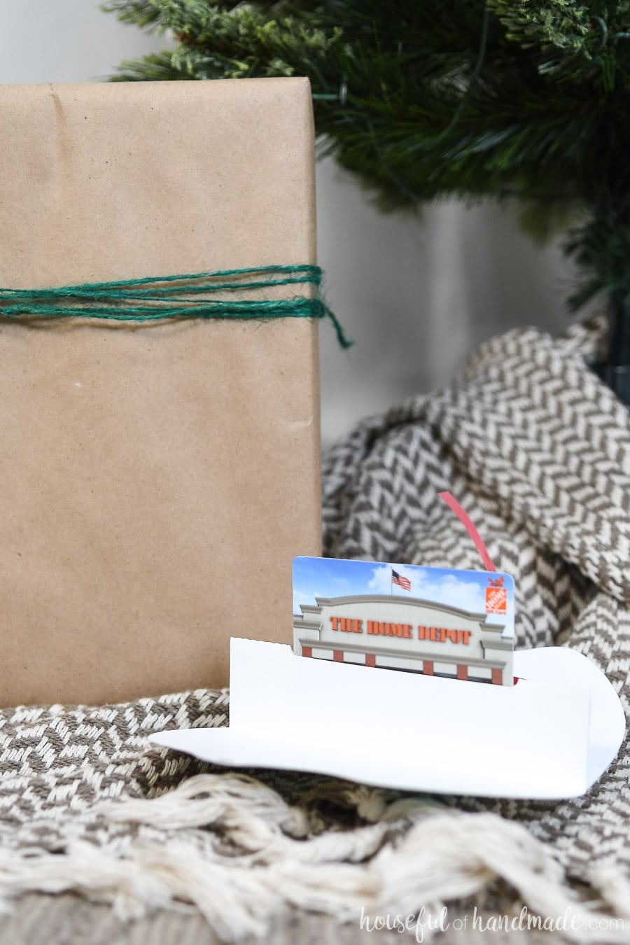 Printable Christmas gift card holder opened up to reveal the pop-up gift card inside.