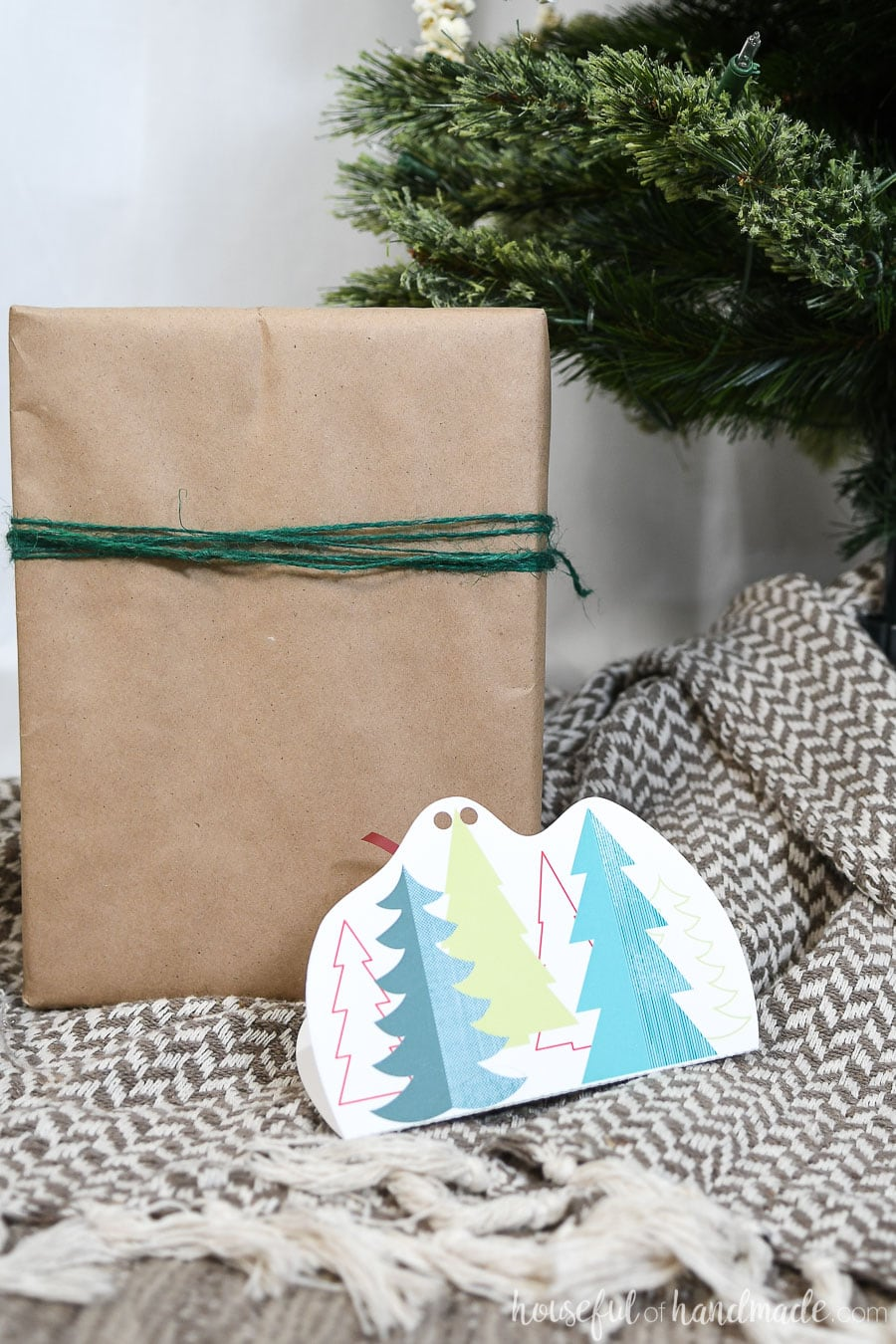Christmas tree print on the front of a gift card holder.