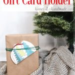 Printable christmas gift card holder on a present with words written above it.