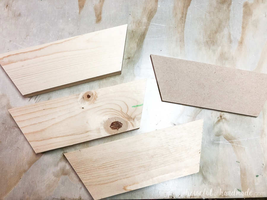 A picture of all the pieces cut for the wooden phone speaker.