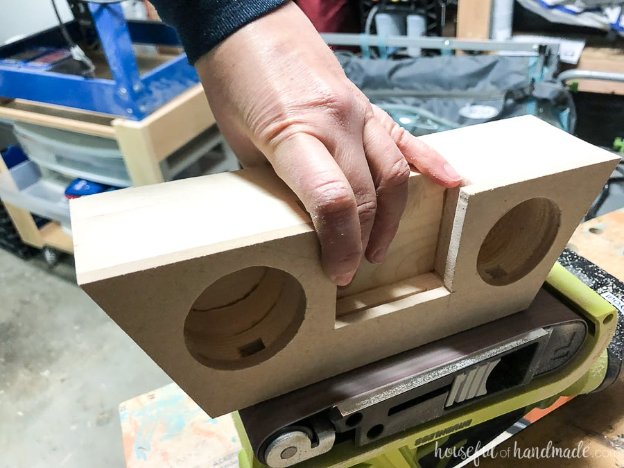 Sand the edges of the wooden speaker to make sure they smooth.