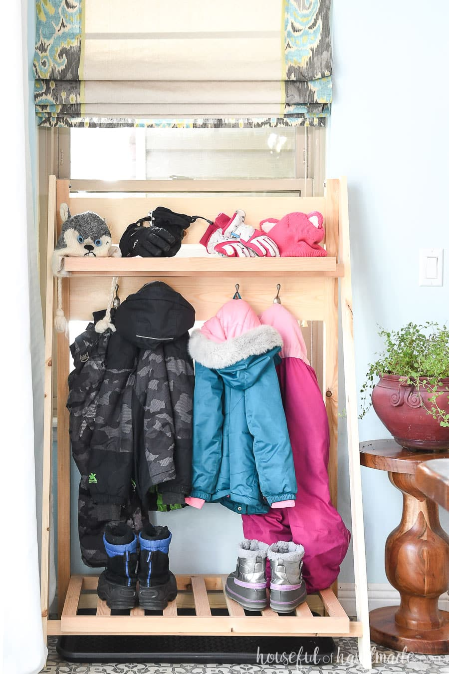 Front view of the collapsible storage shelves for the mudroom.