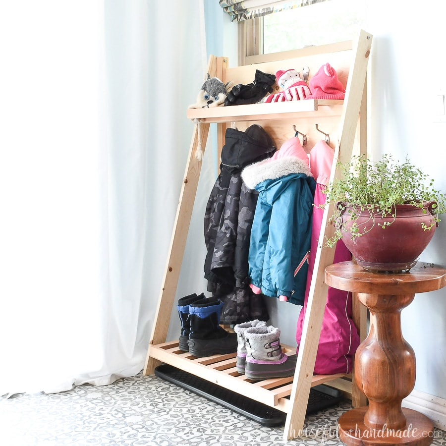 Square picture of the fold-up storage shelves holding extra seasonal gear in the mudroom.