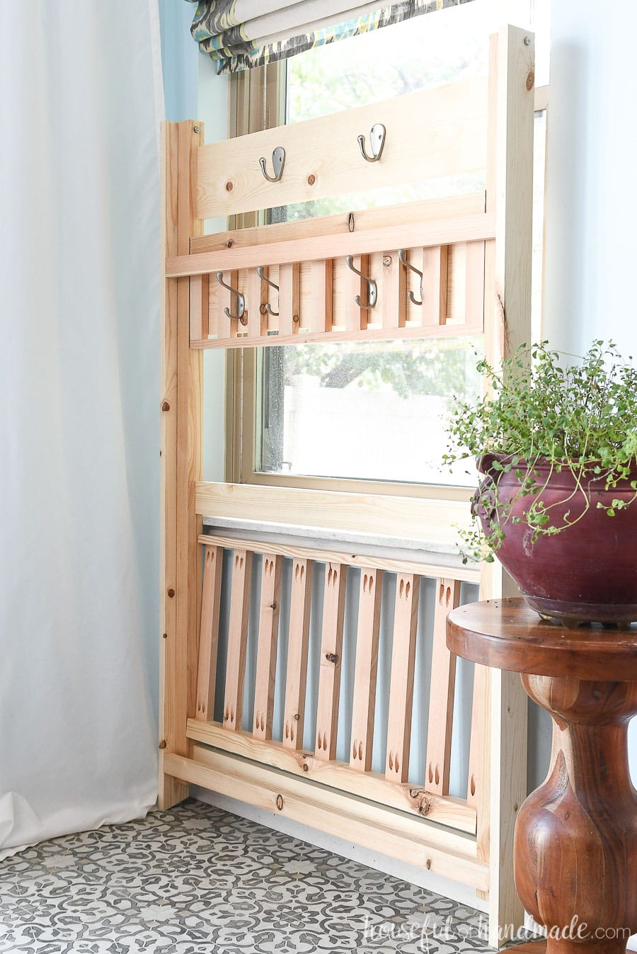The collapsible mudroom storage shelves folded up flat for storage.