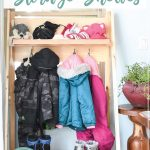 """Front view of the fold-up storage shelves in the mudroom with words """"Collapsible Storage Shelves"""" on it."""