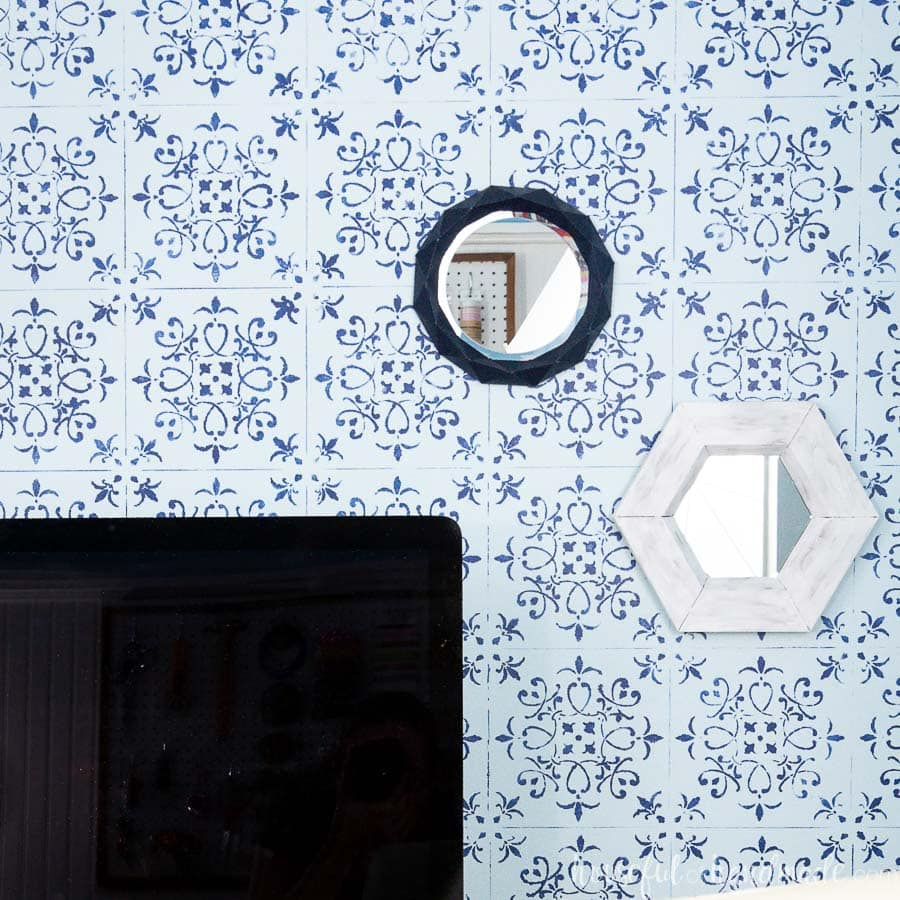 Two decorative wall mirrors, a geometric one and a hexagon wall mirror.