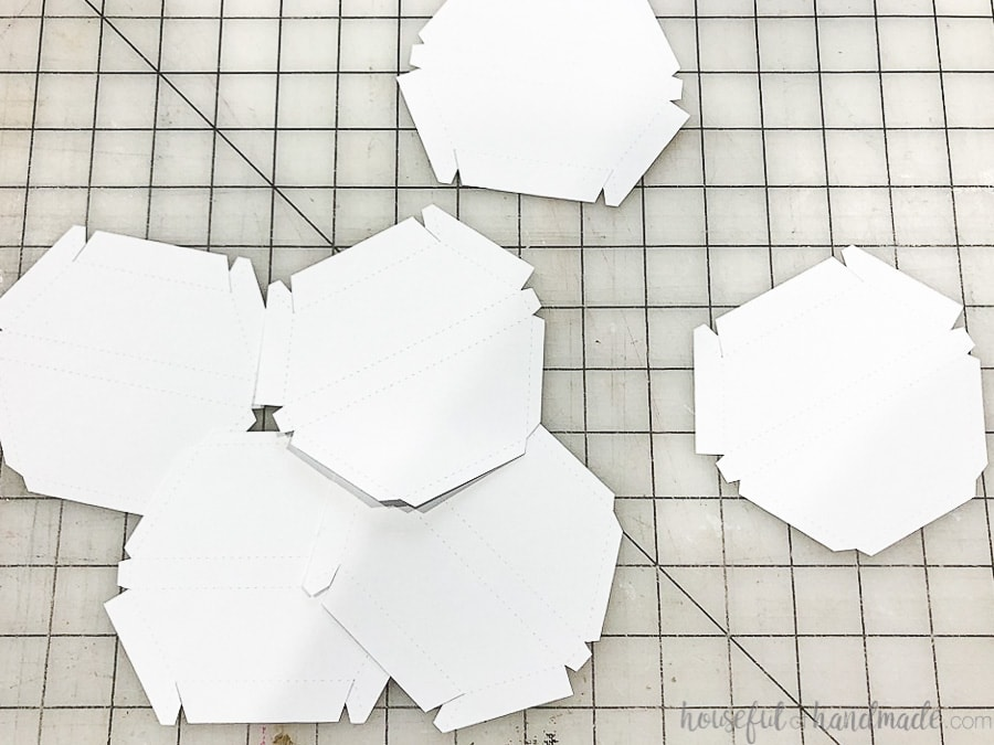 All 6 of the hexagon wall mirror frame pieces cut out of paper.