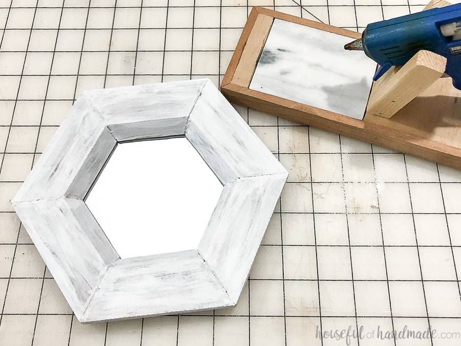 Glue the mirror into the back of your hexagon wall mirror frame.