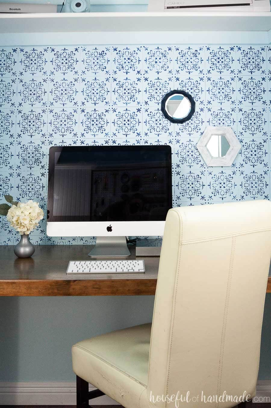Closet desk area decorated with small wall mirrors made out of paper.