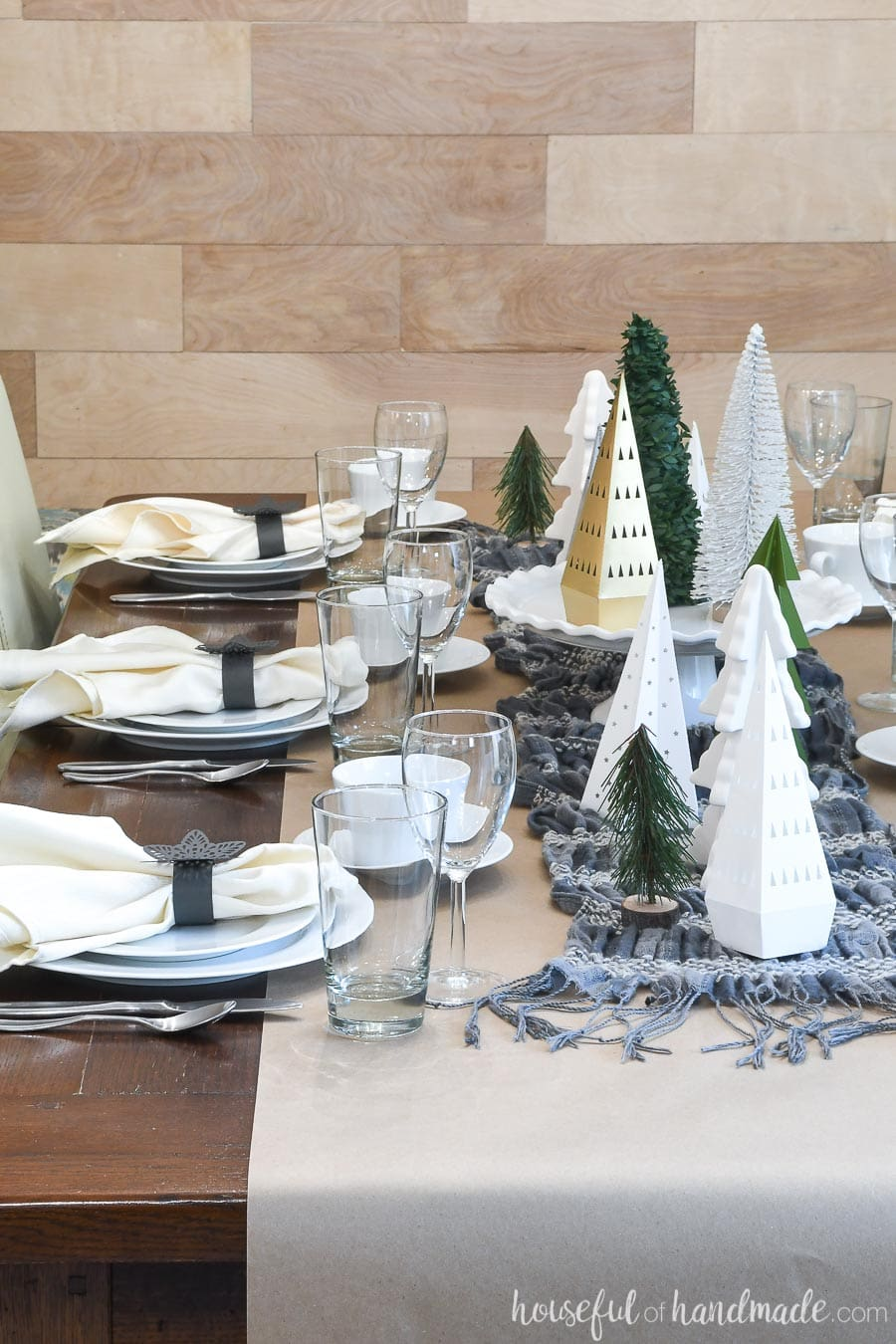 A winter table decorated with left-over Christmas decorations made from paper.
