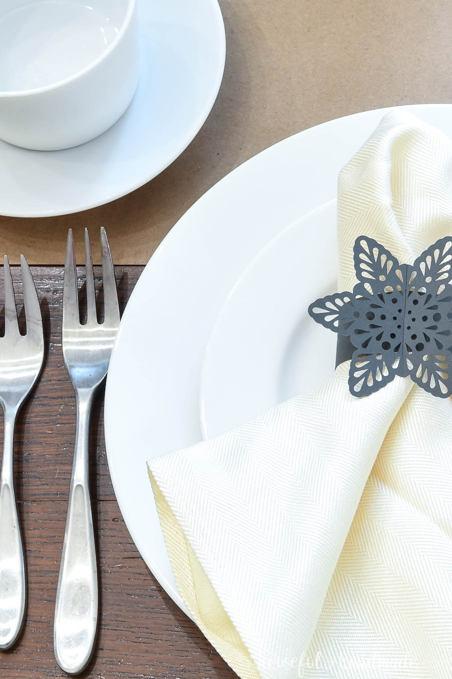 Close-up view of the snowflake napkin rings made out of paper.