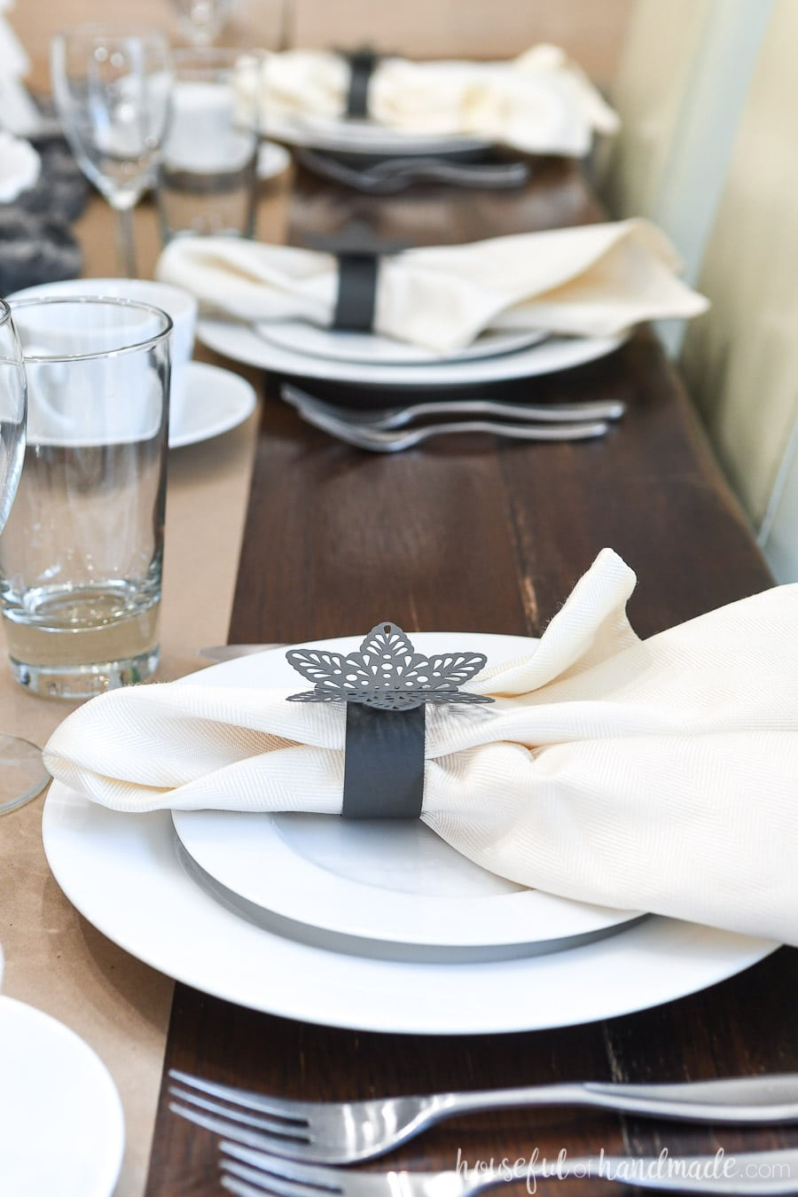 Close-up of the snowflake paper napkin rings on the papercraft winter tablescape.