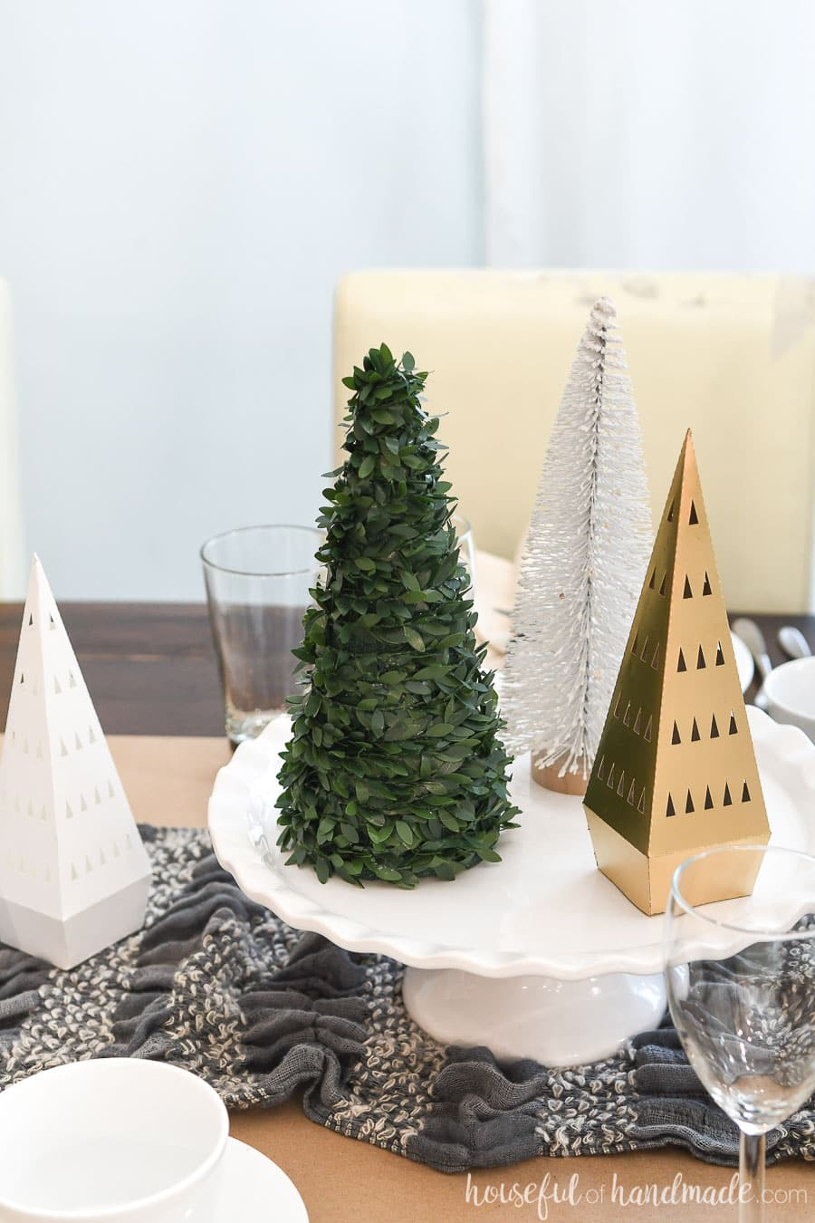 Use a cake plate to add height to the center of a table when decorating.