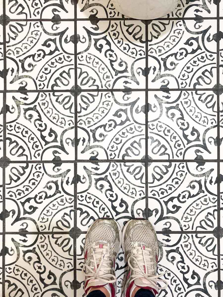 Black and white patterned tile with black grout in the rustic modern guest bathroom.