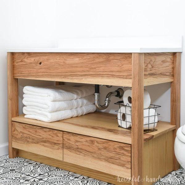 DIY bathroom vanity built from Ash wood with white vanity top.