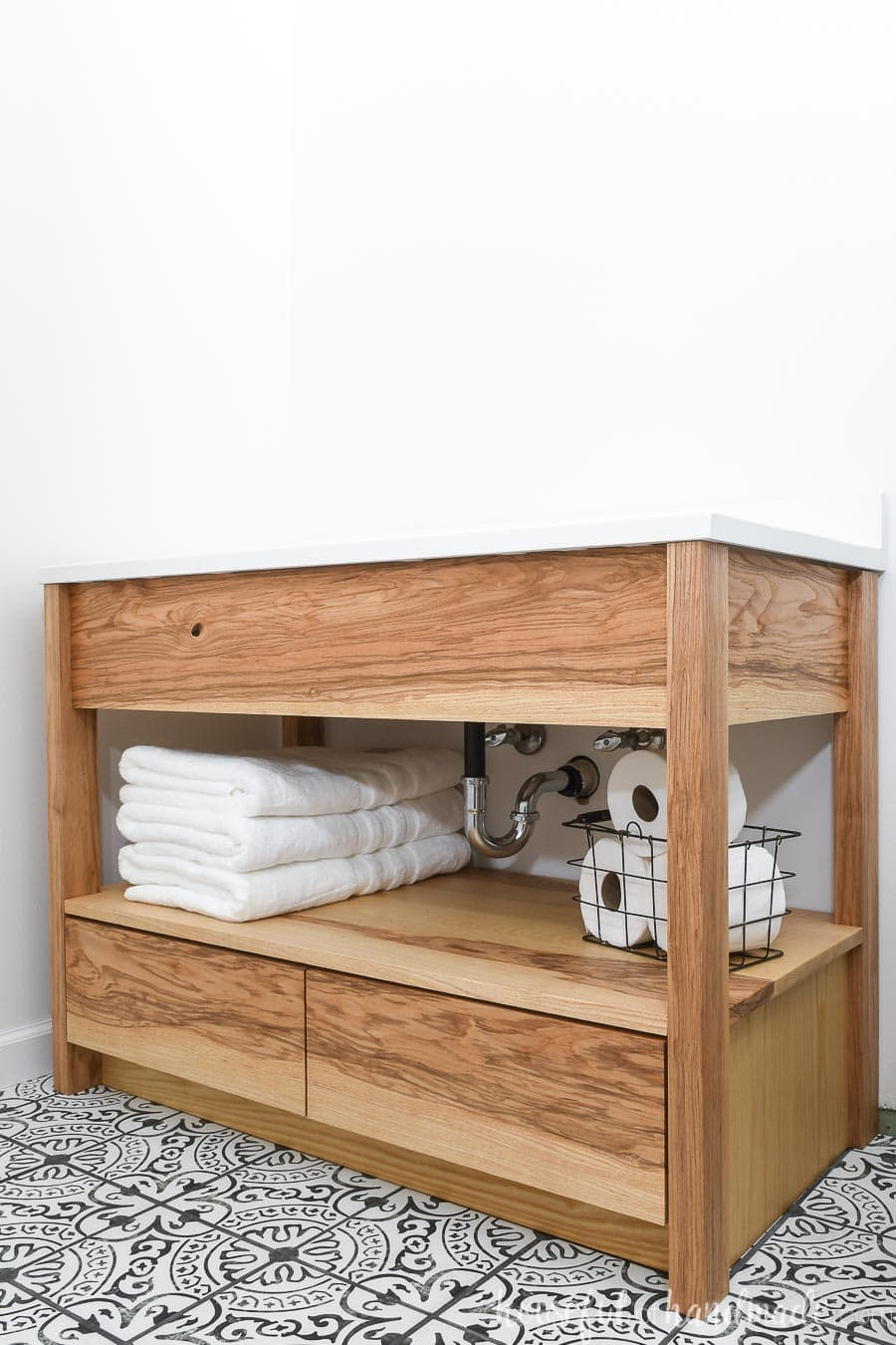 """DIY 42"""" bathroom vanity made from ash wood with an open shelf for towels and bottom drawers."""