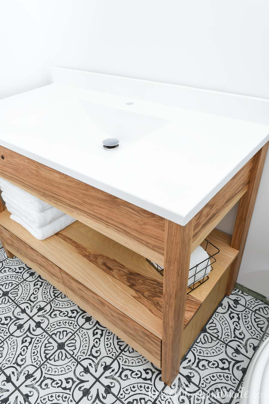 "White one-piece vanity top with sink on top of a 42"" bathroom vanity built from these free plans."