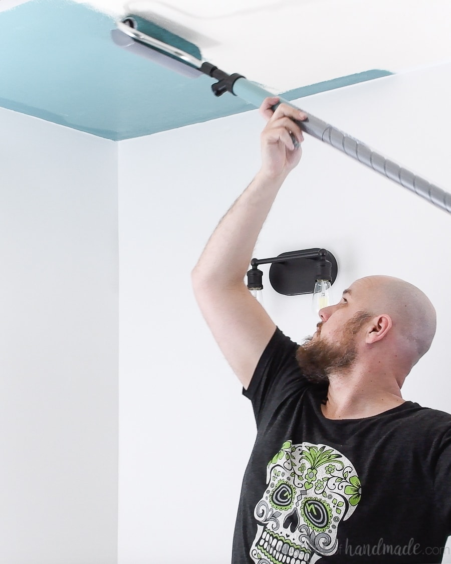 Rolling colorful paint on the ceiling with the HomeRight PaintStick EZ Twist.