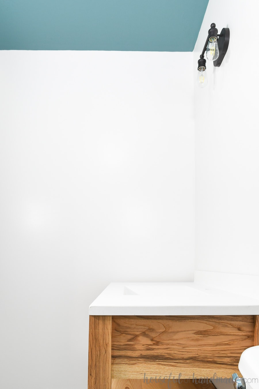 Guest bathroom with wood vanity and bold painted ceiling.