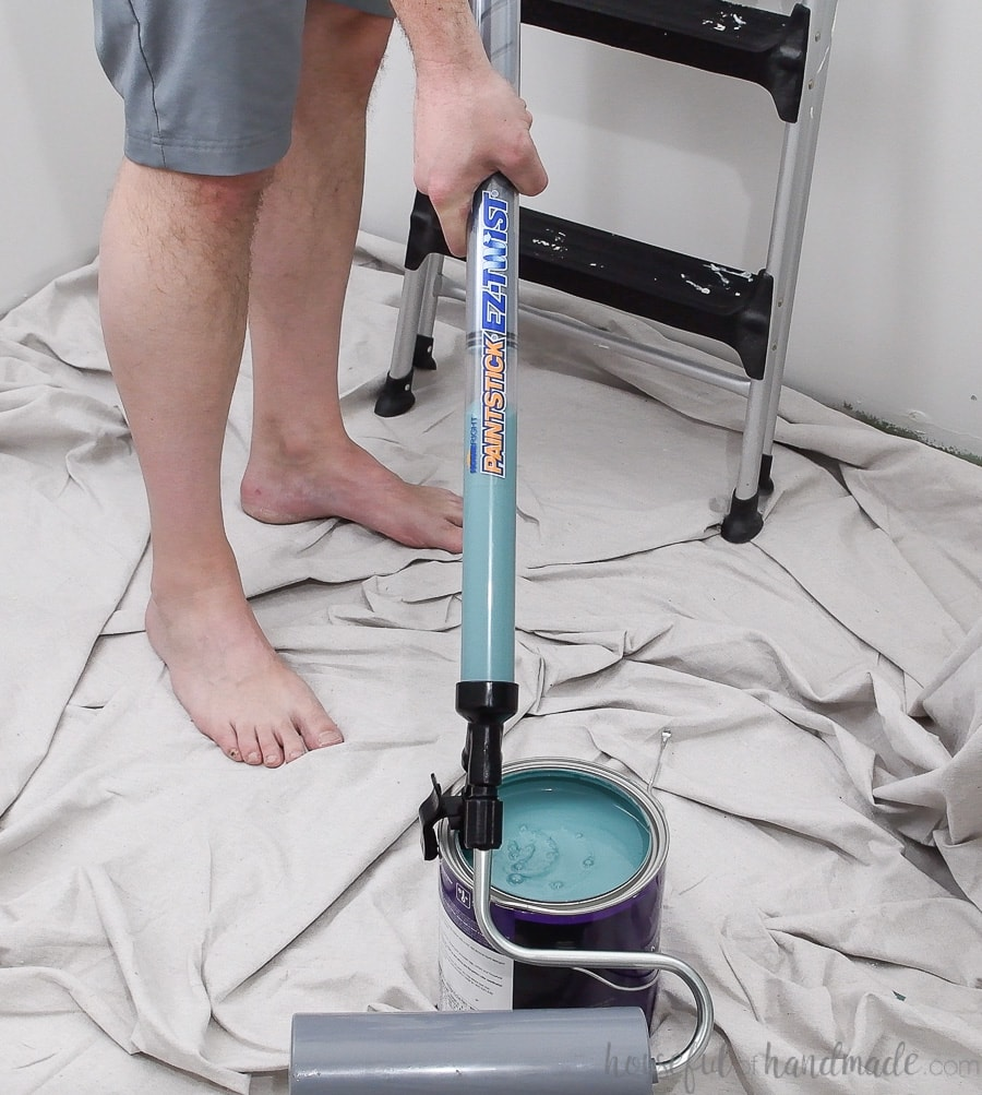 Filling the PaintStick with the modern turquoise ceiling paint.