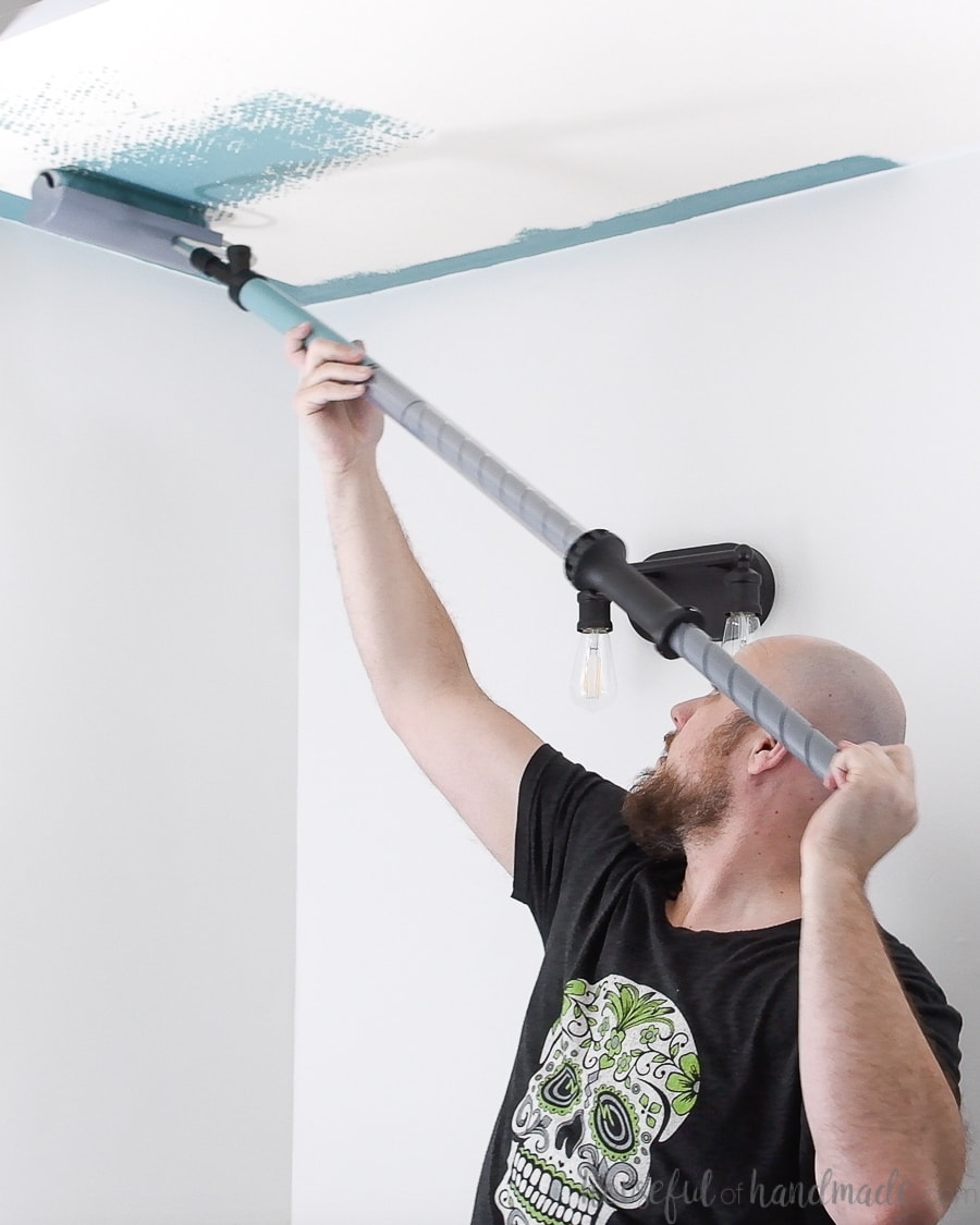 Priming the PaintStick roller as you start painting the ceiling the easy way.