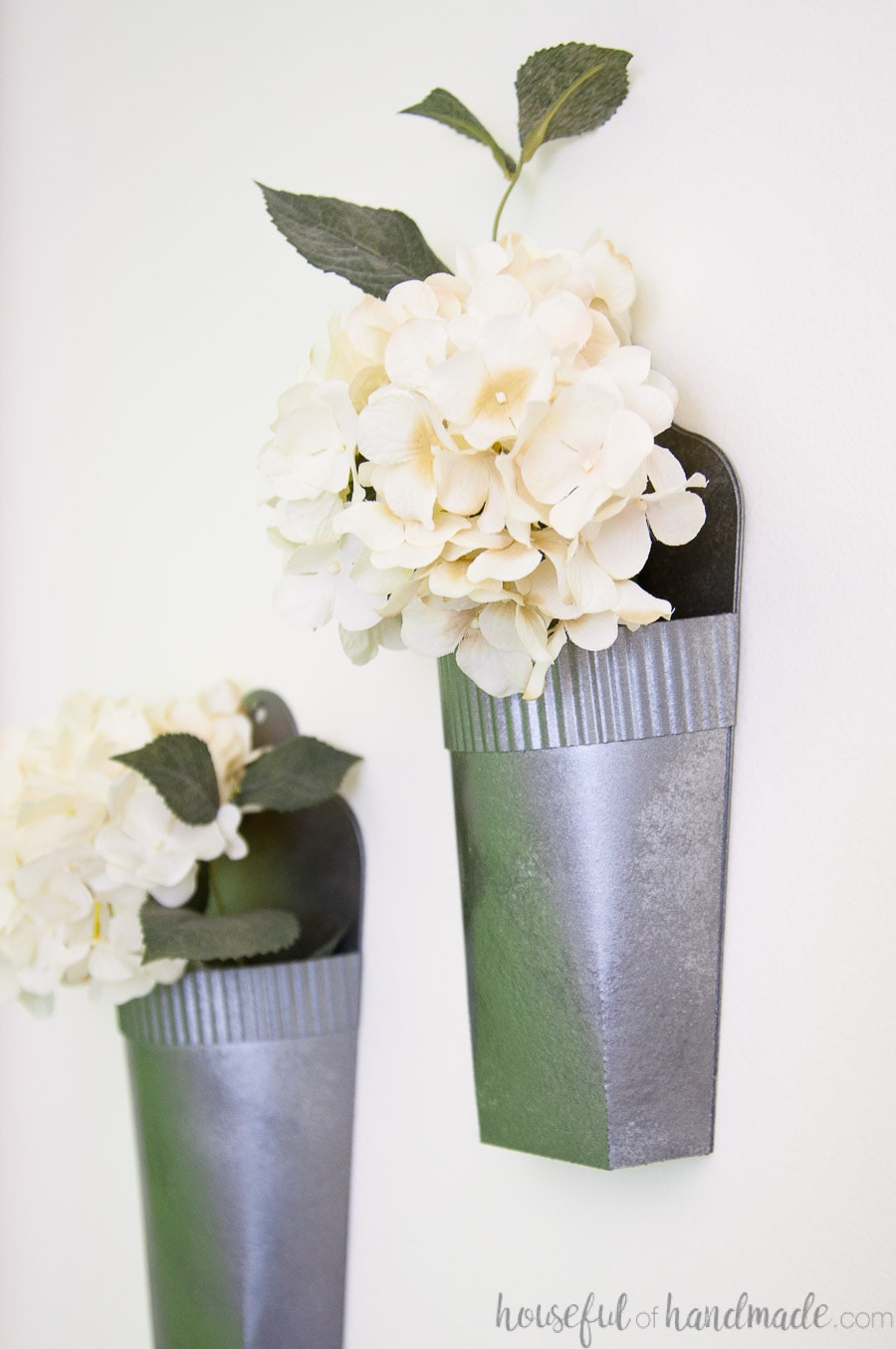 Close up view of the hammered metal spray paint on the wall vases.