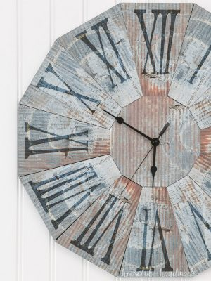 Close-up view of the texture on the rusted steel clock made out of paper.