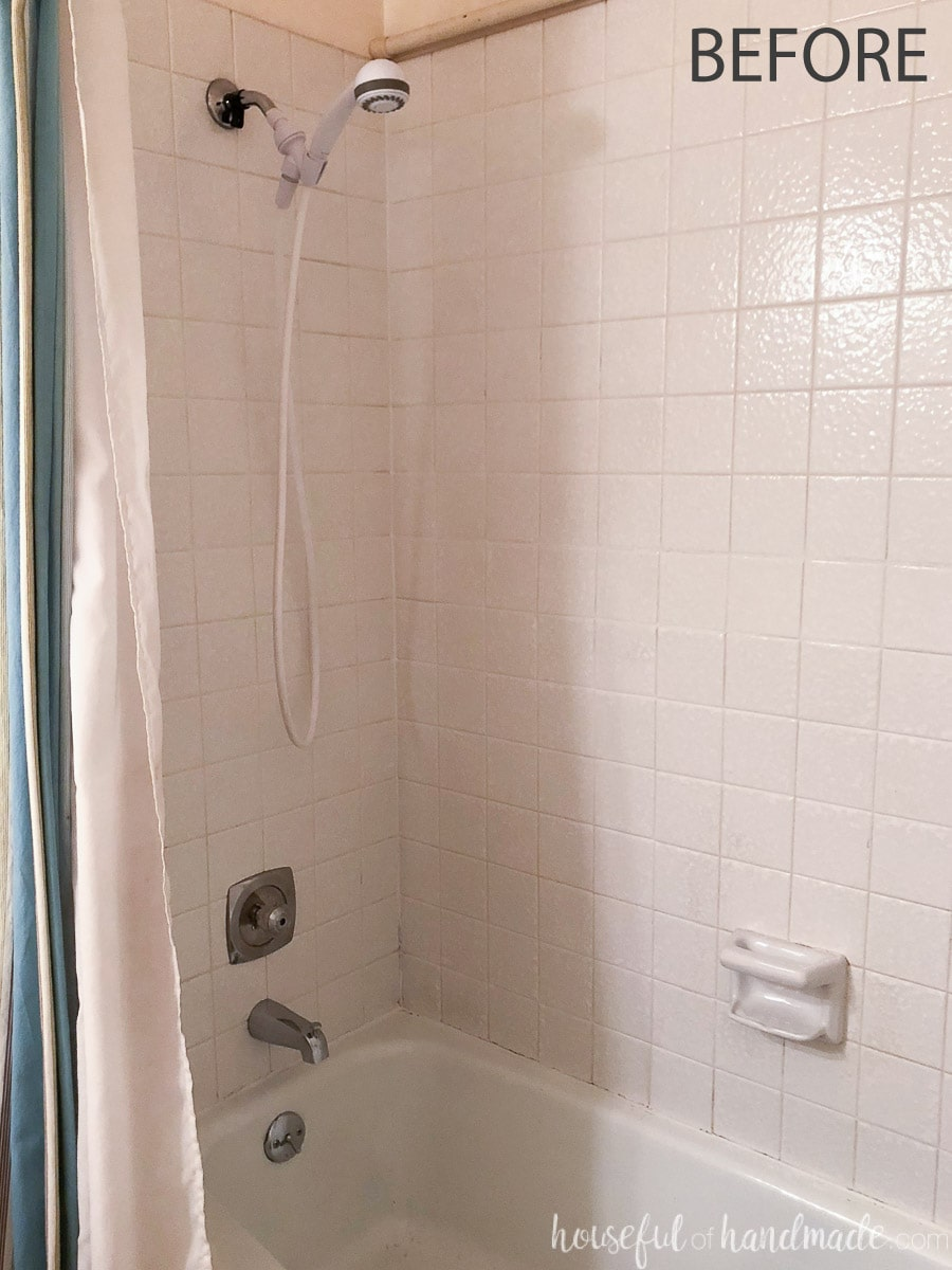 Before view of the shower in the guest bathroom before the rustic modern remodel.
