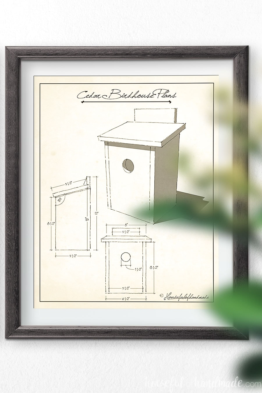 Cedar birdhouse plans art in a frame on the wall.