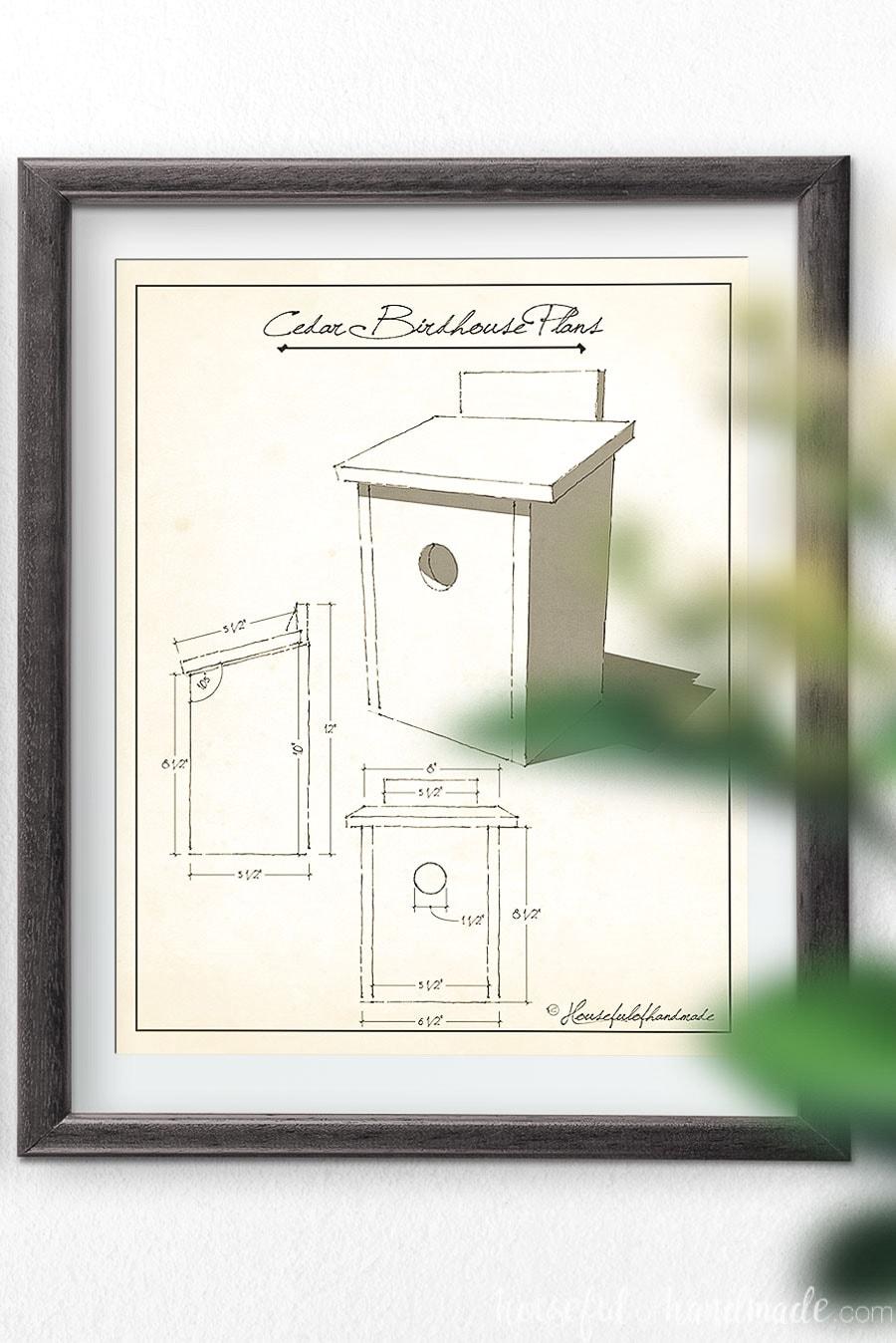 Cedar birdhouse plans art in a frame on the wall.