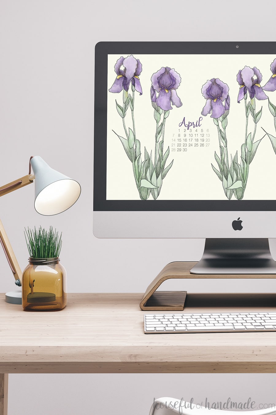 iMac computer with hand-drawn iris digital wallpaper on the screen.