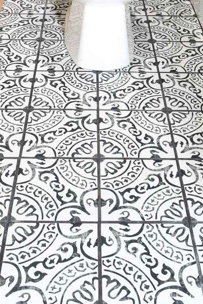 Square photo of black and white tile layout in bathroom.