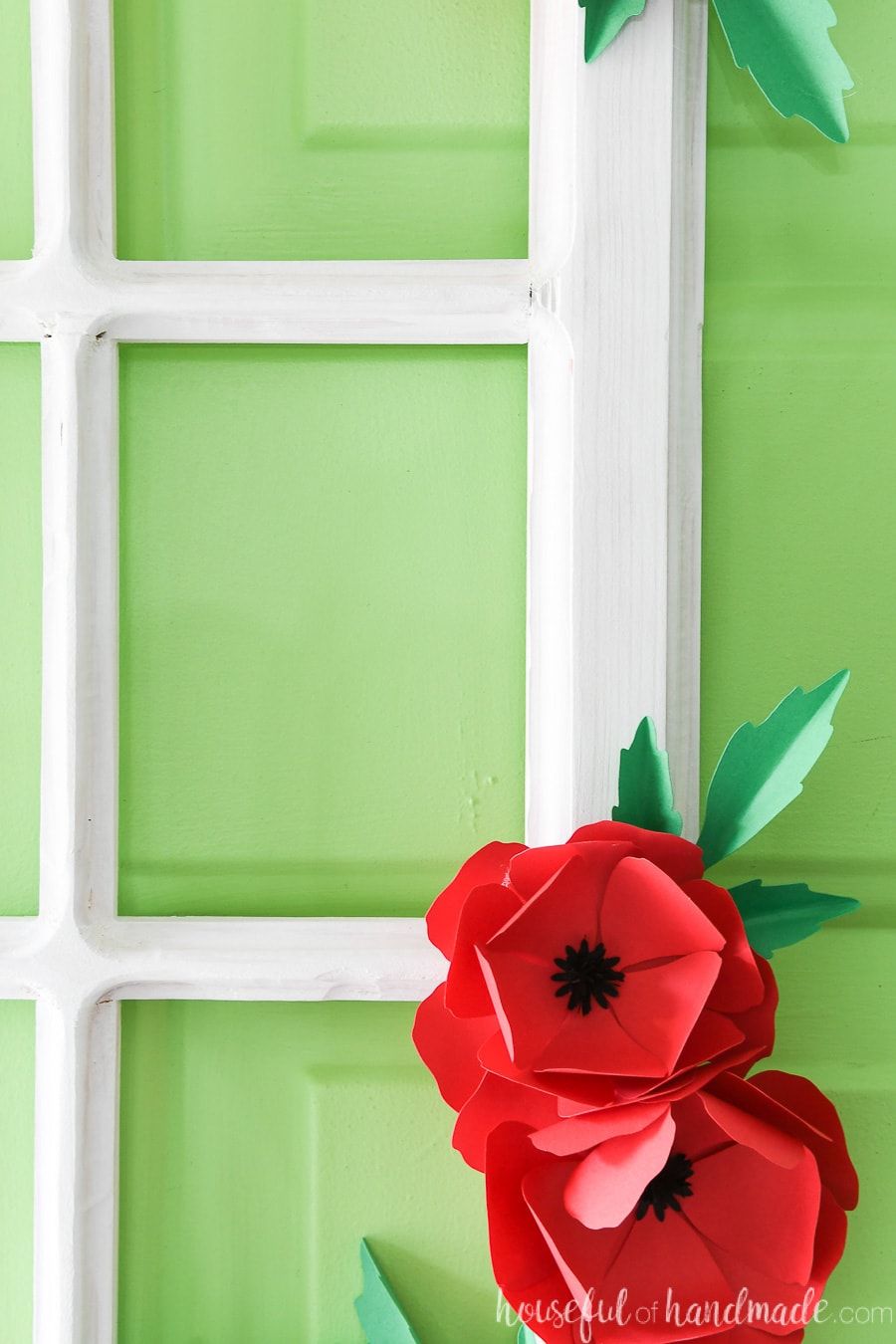 Close up view of the routed edges of the window frame wreath and the paper flowers.